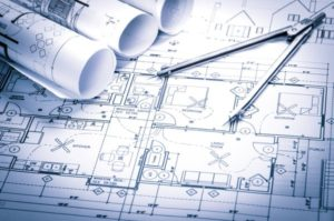 Building plans laid out on table