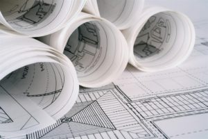 Building plans rolled up on a table