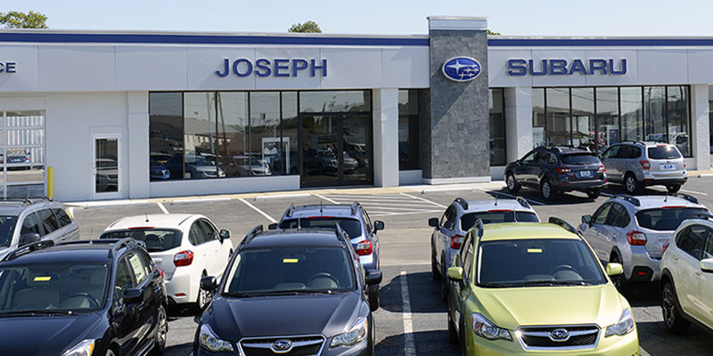 Joseph Subaru building with cars parked in front